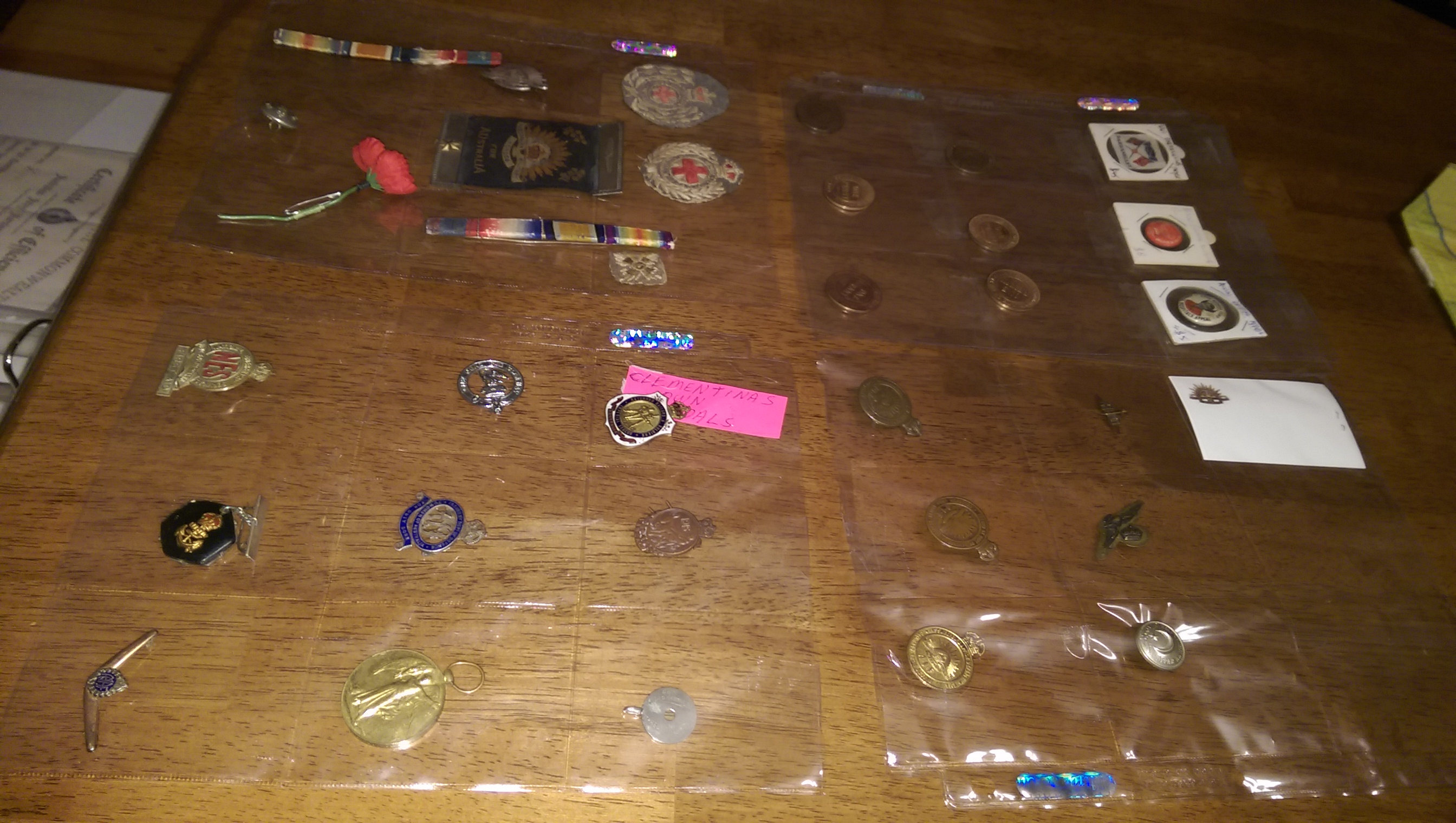 DISPLAYING CLEMENTINA MARSHALLS UNIFORM BADGES & MEDALS