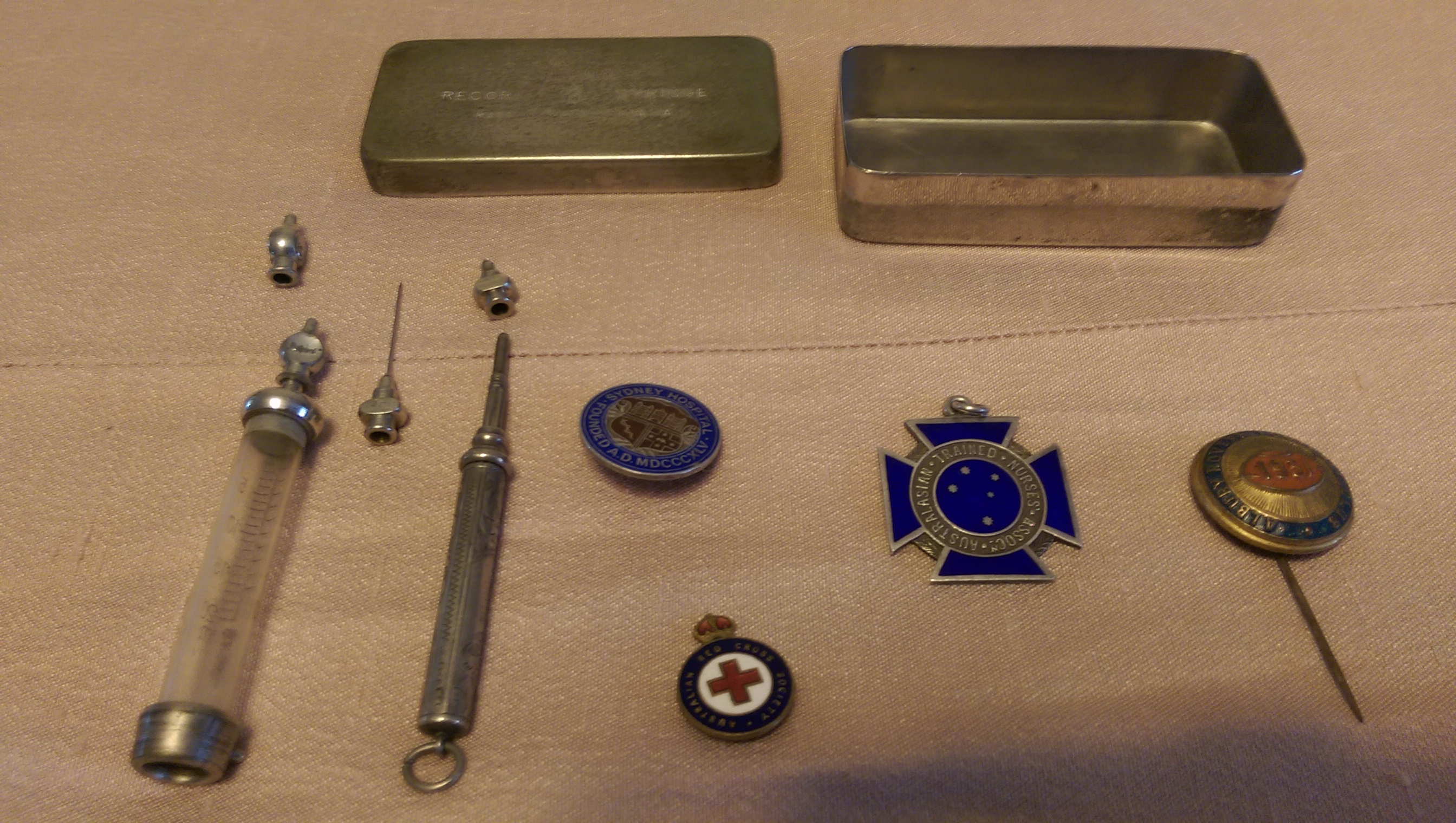 109 YEAR OLD CLEMENTINA PRIVATE NURSING STAFF BADGE OFF HER UNIFORM SYDNEY HOSPITAL. THE SYRINGE IS