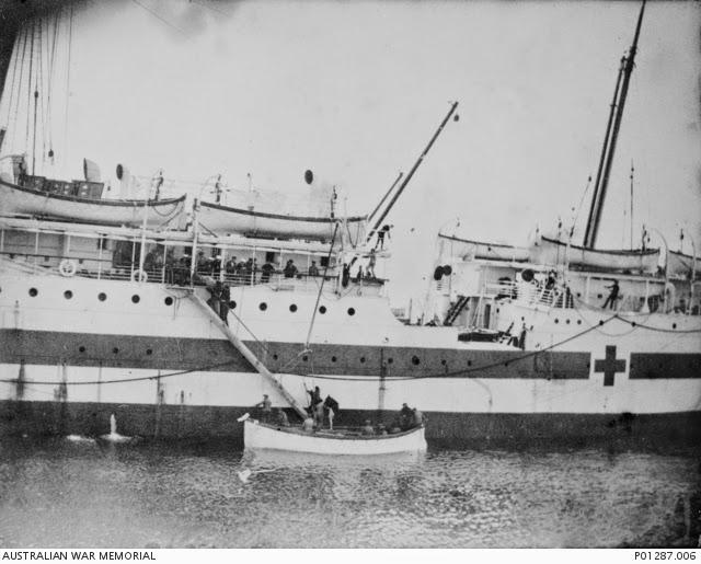 NOTE RED BANDS ALONG BOTH SIDES OF CONVERTED SHIP. DURING THE WAR TIME THESE RED CROSSES WERE ENLARG